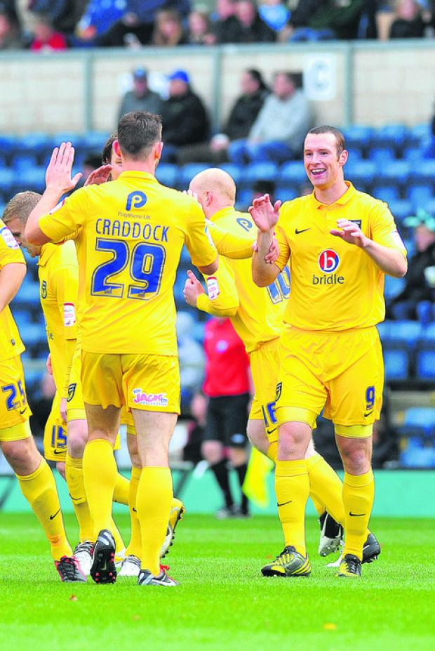 James Constable congratulates Tom Craddock on scoring at Wycombe recently. Craddock leads Constable 10-3 in the race to be United's top scorer