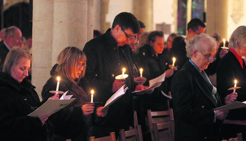 The congregation light candles at St Mary the Virgin Church in Thame