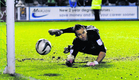 Ryan Clarke saves the first of two penalties on Tuesday, after telling the takers he would stay in the middle of the goal