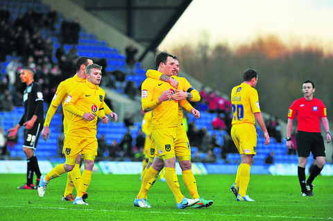 Oxford's players celebrate Adam Chapman's goal