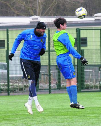 Michael Duberry leaps to win a header in yesterday's practice game – his first match for seven months