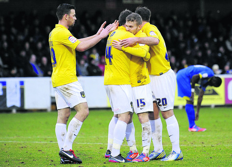 Alfie Potter (No 15) celebrates his header against AFC Wimbledon last Saturday  Picture: David Fl