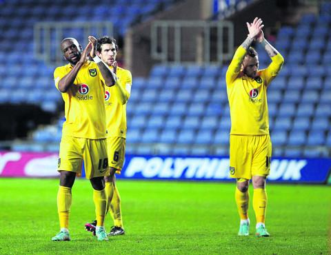 Banbury Cake: Justin Richards (left), Jake Wright and Sean Rigg (right) show their appreciation to the Oxford United fans after the 3-0 FA Cup defeat at home to Sheffield United on Saturday
