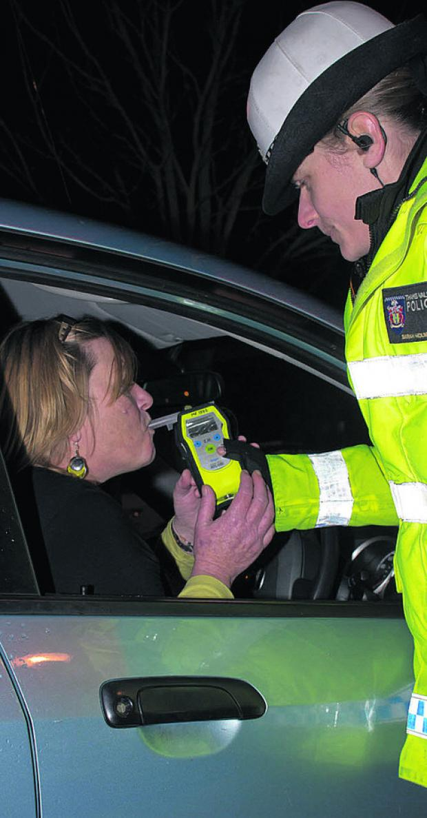 Banbury Cake: Amanda Cherry is breathalysed by Pc Sarah Holmwood after leaving an office party as part of the annual Christmas campaign by Thames Valley Police. She proved negative, as did all other drivers tested that night