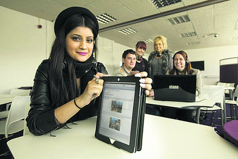 Armna Sarwar shows off the webinar on a tablet. Also pictured are Aaron Scott, Abigail Head, Abeygail Walton and Kelly Boast. Picture: OX57076 Antony Moore