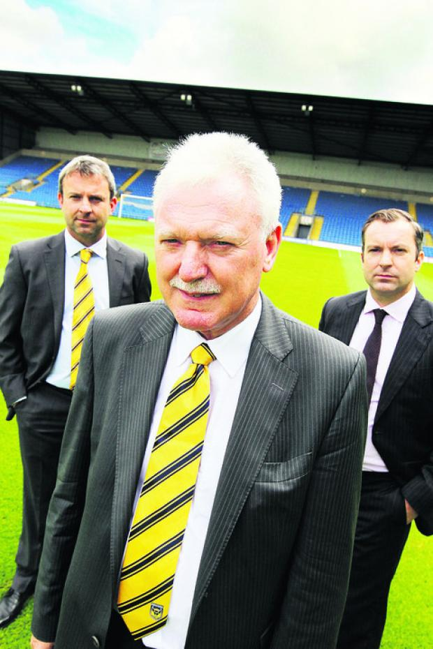 Ian Lenagan with sons Simon (left) and Adrian, who make up Oxford United's board