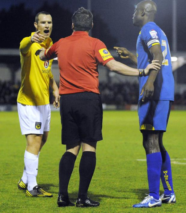 James Constable (left) was sent off after a clash with Wimbledon's Will Antwi