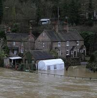 Politicians must ensure rigorous planning to prevent building in flood plains as well as enough flood defences planning, say insurers