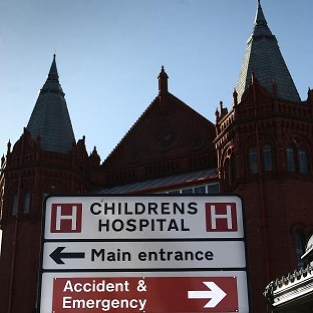 A young boy died at Birmingham Children's Hospital after being found collapsed at home