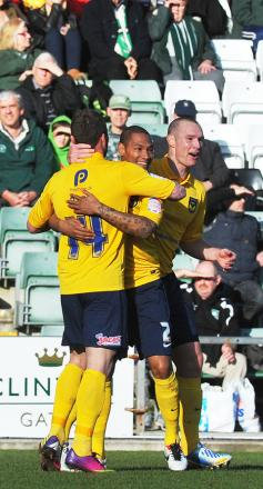 United's James Constable (right) celebrates his historic goal against Plymouth on Saturday that took him third on United's all-time list