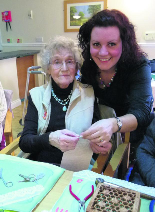 Oxfordshire artist Helen Jacobs, right, with Spencer Court resident Audrey Scott