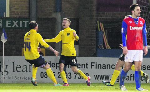 An ecstatic Alfie Potter is congratulated by Sean Rigg after scoring the winner at Gillingham on Tuesday night