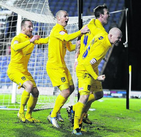 Oxford United celebrate a late winner from Michael Raynes (No 4) against Barnet on Tuesday  Picture: David Fleming