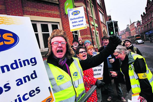 Wayne Meade, front, and colleagues picket Oxford's JobCentre