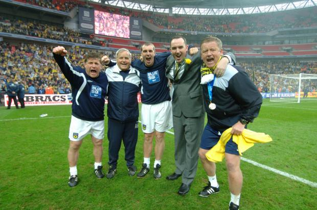 Banbury Cake: Chris Wilder celebrates winning promotion at Wembley with his backroom team and chairman Kelvin Thomas