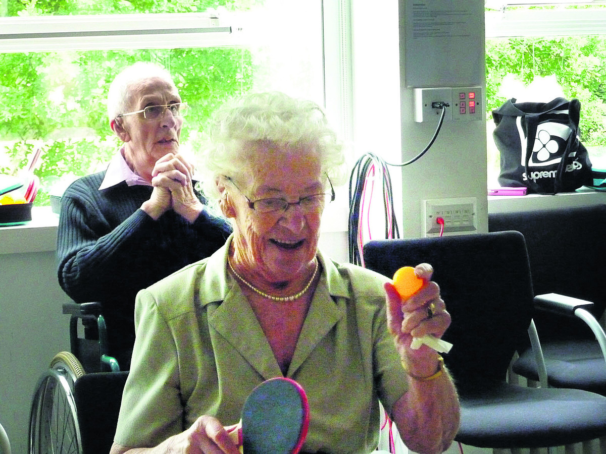 Gladys Brown, 87, gets set to play table tennis