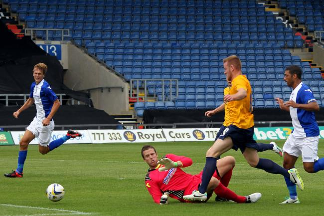 Deane Smalley slides the ball past goalkeeper Colin Doyle to finish off a spectacular solo effort