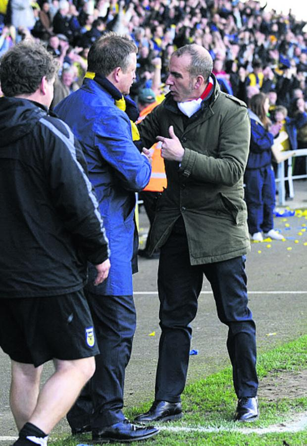 Banbury Cake: Paolo Di Canio has words with Oxford United boss Chris Wilder at the Kassam Stadium in March 2012 during his spell at Swindon