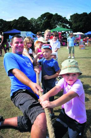 Martin Gillet, pictured taking part in a tug of war at one of the summer events, has been invited to a Downing Street reception