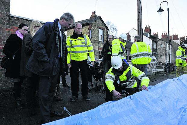 Banbury Cake: Environment Secretary Owen Paterson is shown the flood defences at Oxford's Osney Island by Al Wells of the Environment Agency