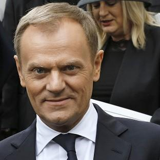 Polish PM Donald Tusk says Poles should not be singled out in the row over benefits for migrants' families.