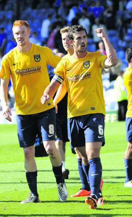 Jake Wright leads the celebrations as Oxford beat Portsmouth 4-1 at Fratton Park on the opening day of the season