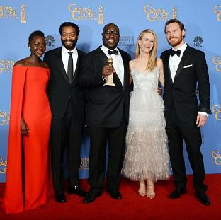 Banbury Cake: From left, Lupita Nyong'o, Chiwetel Ejiofor, Steve McQueen, Sarah Paulson and Michael Fassbender with the award for best motion picture - drama (AP)