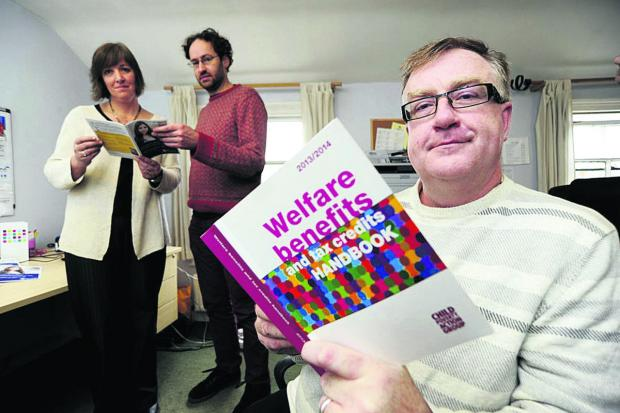 Banbury Cake: Mind Oxfordshire assistant manager Susannah Lloyd-Shogbesan, hotline volunteer Adam Moore and David Bryceland, project manager for Benefits for Better Mental Health Picture: OX64641 David Fleming