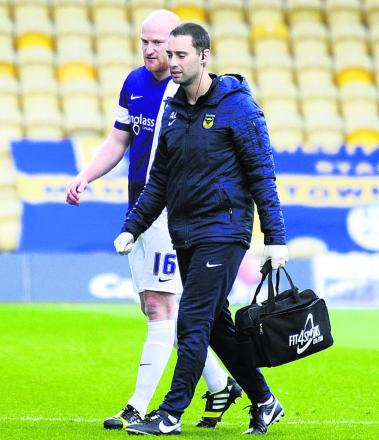 Andy Whing comes off at Mansfield with physio Andy Lord