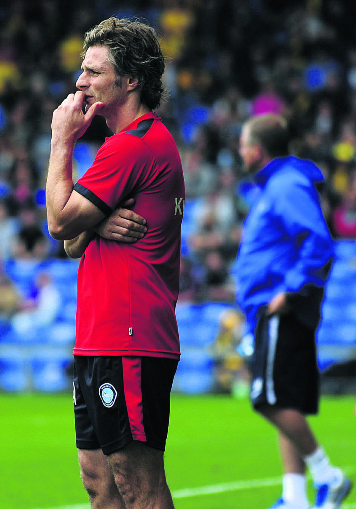 Gareth Ainsworth on the touchline with Chris Wilder in the background during August's meeting at the Kassam