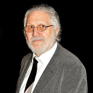 Banbury Cake: Former Radio 1 DJ Dave Lee Travis is charged with 13 counts of indecent assault dating back to 1973 and one count of sexual assault in 2008