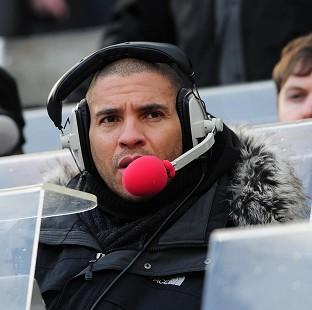 Banbury Cake: Police are investigating a series of offensive messages directed at Stan Collymore