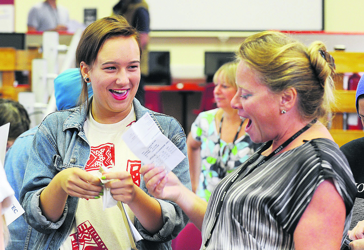 Dagmara Michno celebrates with Cheney School headteacher Jolie Kirby on GCSE results day last August.