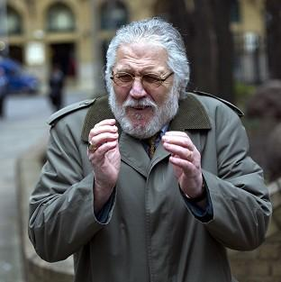 Former DJ Dave Lee Travis arrives at Southwark Crown Court in London, where he is accused of a series of indecent