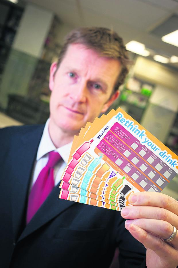 Banbury Cake: Stuart Gale, owner of Frost Pharmacies, with one of the scratch cards