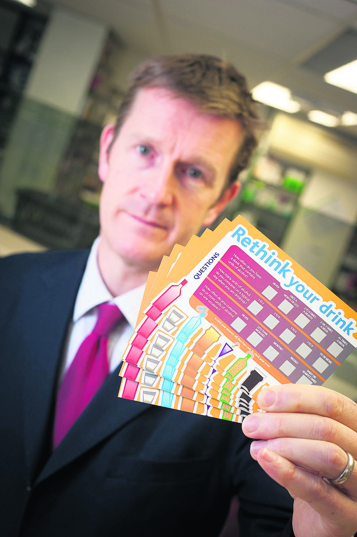 Stuart Gale, owner of Frost Pharmacies, with one of the scratch cards