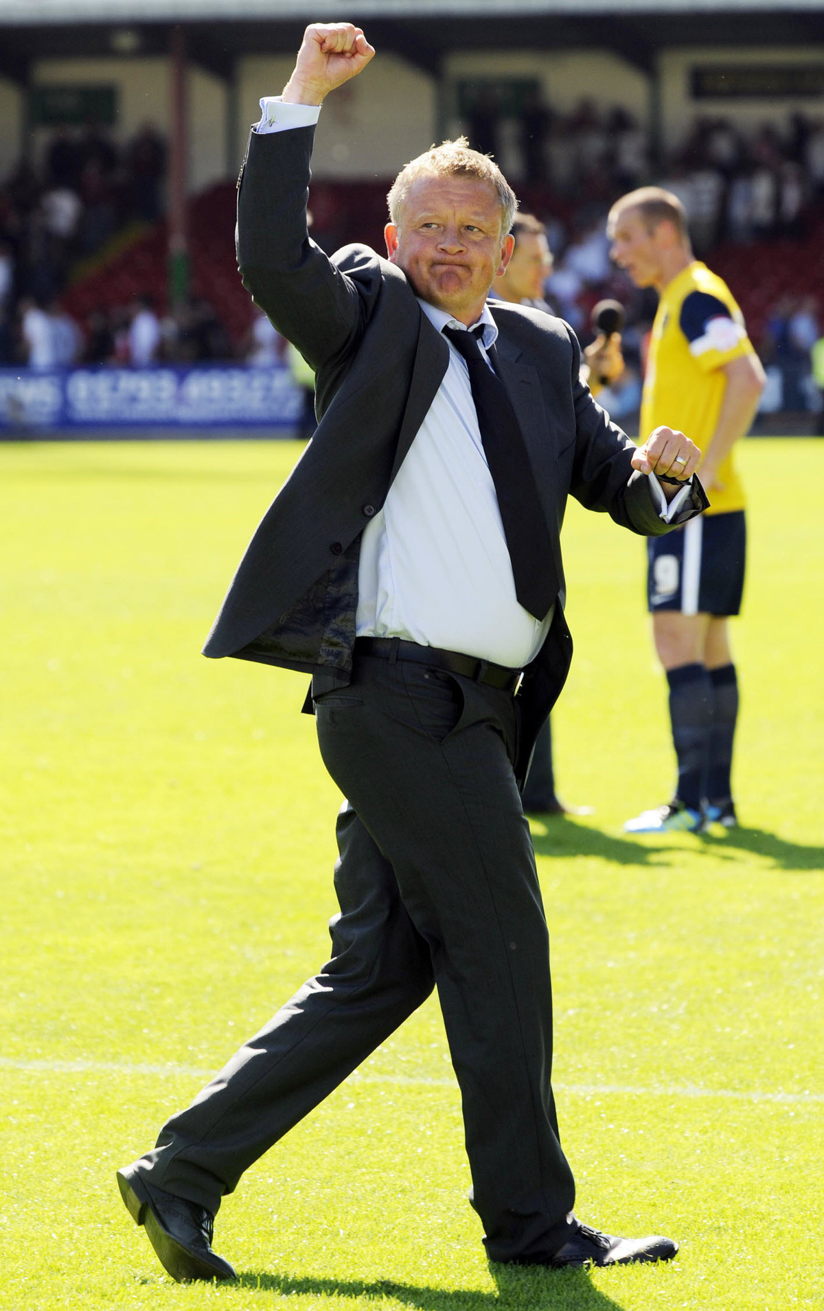 Chris Wilder celebrates Oxford United's 2-1 win over Swindon at the County Ground