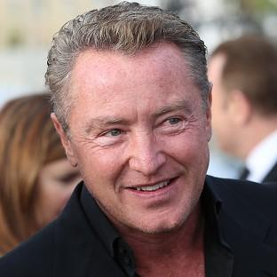 Michael Flatley's home is believed to have been burgled by a traveller gang