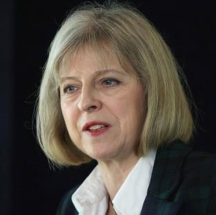 Banbury Cake: Home Secretary Theresa May told MPs that she was working with Foreign Secretary William Hague on 'further support' which could be offered to refugees