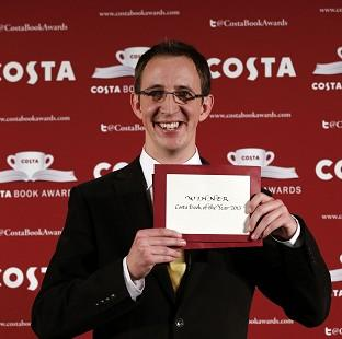Nathan Filer accepts the 2014 Costa Book Award for his novel 'The Shock of the Fall' at