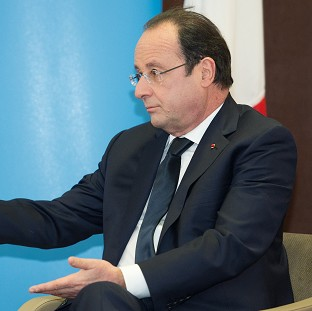 French president Francois Hollande during a meeting with Prime Minister David Cameron during a one-day summit at RAF Brize Norton