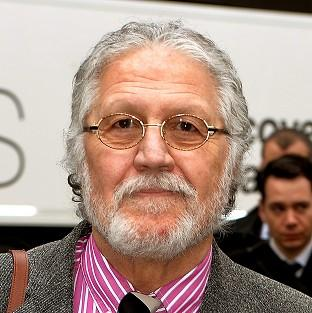 DJ Dave Lee Travis arrives at Southwark Crown Court in London, where he is accused of 13 counts of indecent assault and one count of sexual a