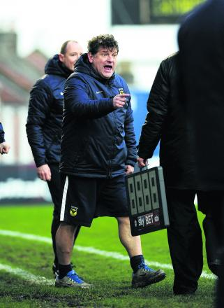 Oxford United caretaker manager Mickey Lewis makes himself heard on the touchline at Bristol Rovers on Saturday