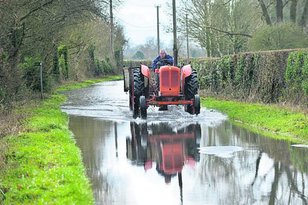 Banbury Cake: A tractor negotiates the floods in Northmoor