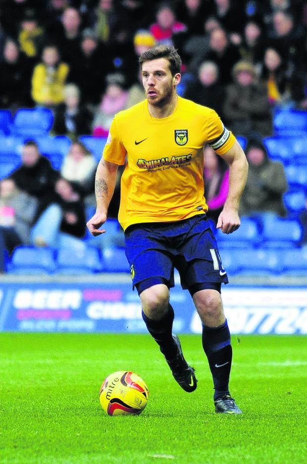 Banbury Cake: CAPTAIN FANTASTIC: Johnny Mullins aims to lead from the front with the Oxford United armband while regular skipper Jake Wright is sidelined
