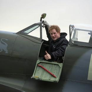 Banbury Cake: Prince Harry sits in a Spitfire during a visit to the Boultbee Flight Academy in Goodwood, West Sussex.