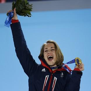 Banbury Cake: Lizzy Yarnold celebrates during the medals ceremony at the Winter Olympics (AP)