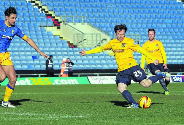 David Connolly fires home his second goal at the Kassam Stadium in two appearances