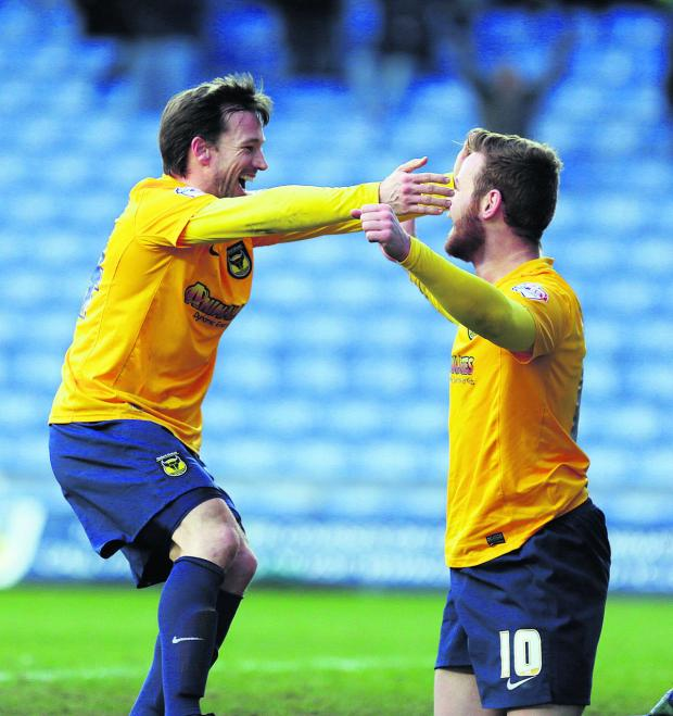 Banbury Cake: A delighted David Connolly (left) is all smiles as he congratulates Deane Smalley on scoring Oxford United's third goal in the 3-0 win over Mansfield Town at the Kassam Stadium on Saturday