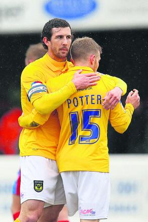 Jake Wright congratulates Alfie Potter's winner at Dagenham - which began United's run last April